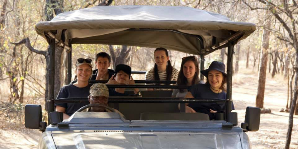 Volunteers in a safari vehicle with a game ranger in Limpopo.