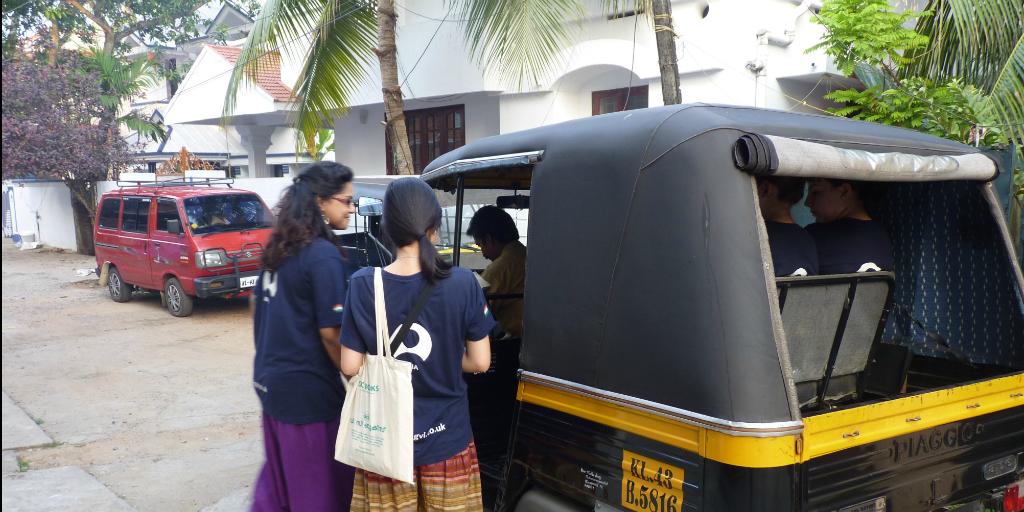 volunteers getting into a tuk-tuk in India
