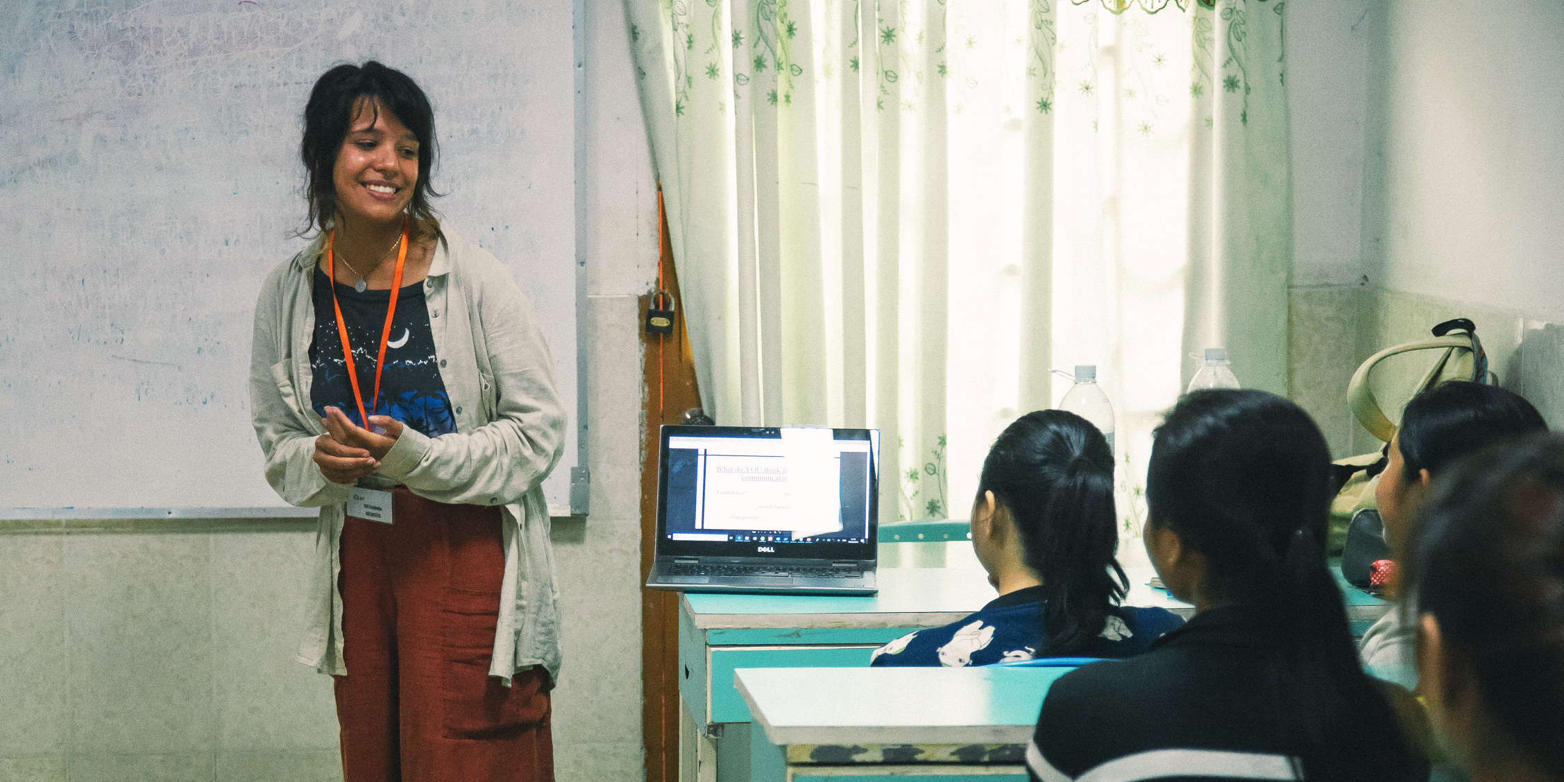 A woman leads an English lesson while on a gap year program.