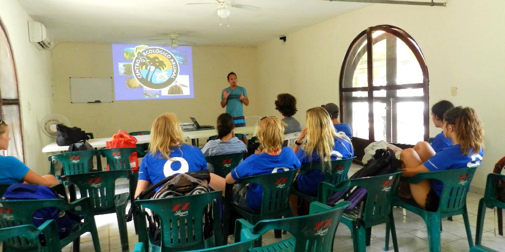 GVI participants sit through an educational class.